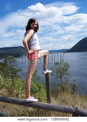 Teen girl is feeling the breeze from the lake
