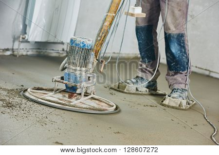 floor machine grinding by power trowel