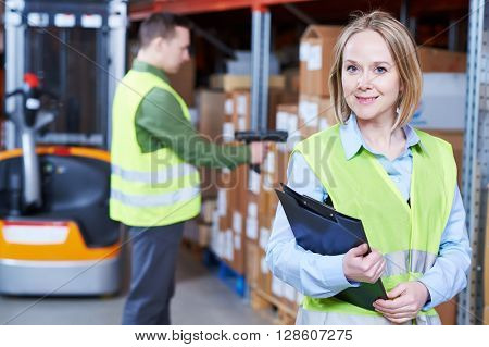 Warehouse Management System. female worker portrait