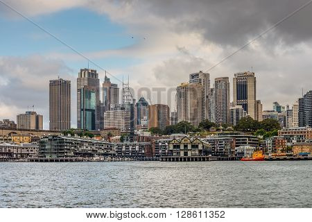 Sydney Australia - November 10 2014: Looking up at the Sydney CBD from Walsh Bay on a cloudy day Sydney New South Wales Australia