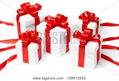 White gift box with red ribbon bow and christmas balls around isolated on white background