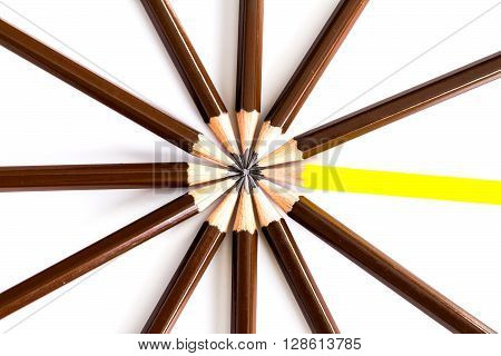 brown wooden pencil arrange as circular with one of different pencil try to close the gap on the white background un matching concept