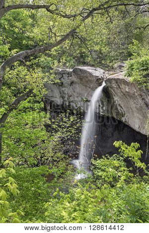 Fall Branch Creek plunges over Williamsport Falls a tall waterfall in Warren County Indiana.