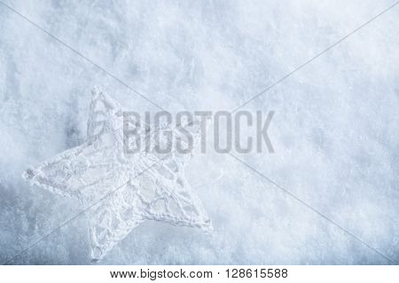 Beautiful star on a white frost snow background. Winter and Christmas concept. Instagram filter.