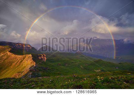Amazing rainbow on the top of grossglockner pass, Alps, Switzerland, Europe.