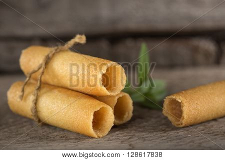 Sweet corn rolls over old rustic wooden background