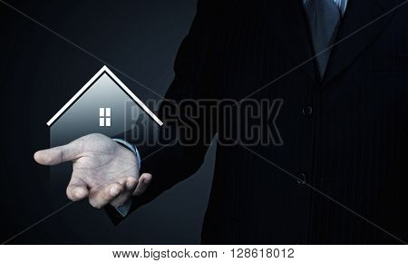 House sign in male hand