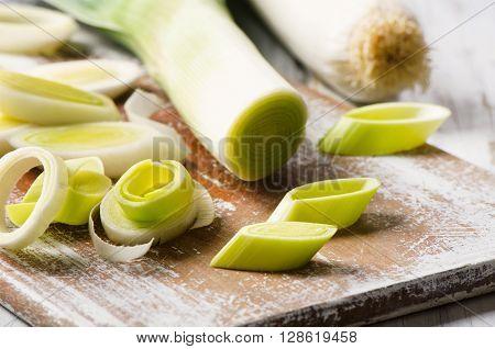 Fresh Leeks On  Wooden Cutting Board.