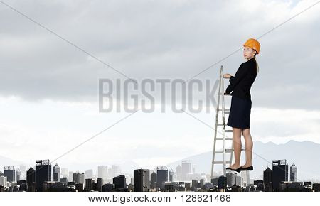 Builder woman viewing city