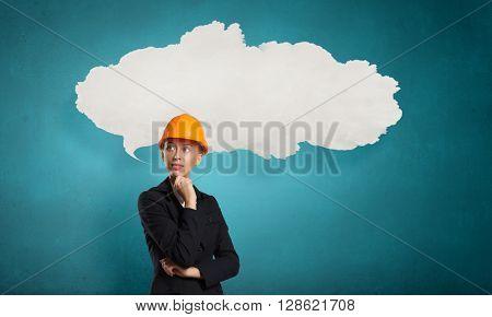 Pensive builder woman