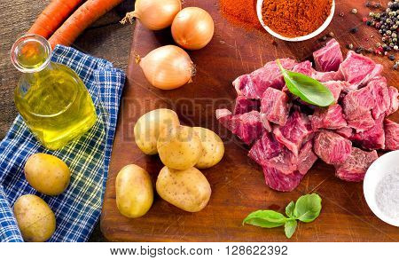 Ingredients For Stew Or Goulash  On Old Cutting Board.