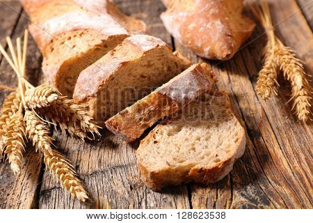 fresh baguette on wood background