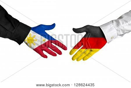 Philippines and Germany leaders shaking hands on a deal agreement