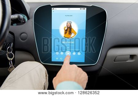 transport, driving, technology, media and people concept - close up of male hand using music player application on car computer