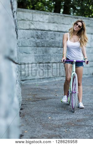 Young girl is exploring the city a bike