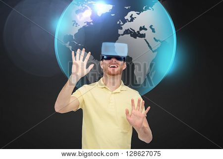 3d technology, virtual reality, global, entertainment and people concept - happy young man in virtual reality headset or 3d glasses playing game over black background with earth planet holgram