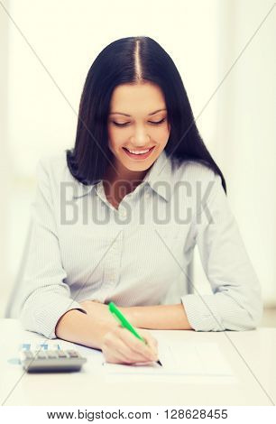 business, education and tax concept - smiling businesswoman or student working with calculator