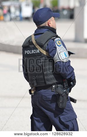 Lisbon, Portugal - March 07, 2016: Policeman  on duty at Praca dos Comercio Lisbon Portugal.