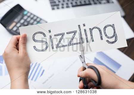 holds card with text sizzling on financial report and calculator