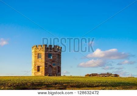Sydney Australia - September 15 2012: 19th century Customs Tower also known as Macquarie Watchtower at La Perouse Botany Bay during the evening