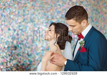 Wedding couple in quarrel. Beautiful bride in white dress and veil with handsom. Husband asking forgiveness