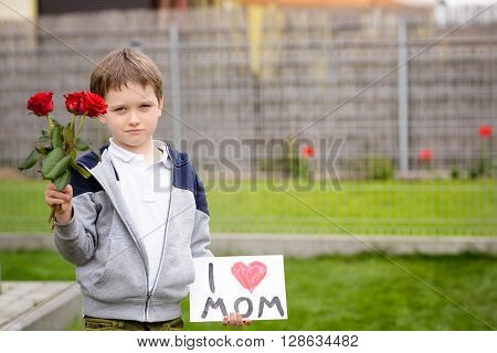 Boy Giving His Mother Self-made Greeting Card