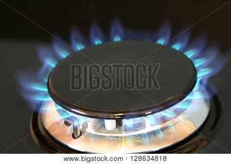 Natural gas burner on home cooking hob unit.