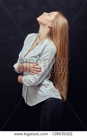 aroused woman with red hair on black background