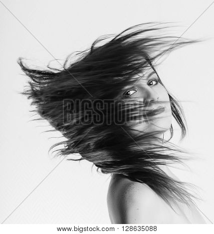 Young Woman with Long Hair Flying in Motion Blur effect monochrome image