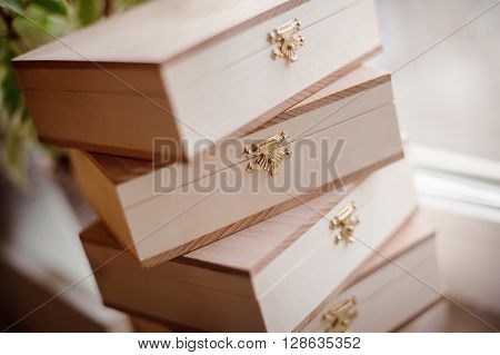a stack of handmade wooden boxes with locks