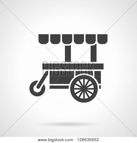 Black cart for street trade. Food trolley. Sale of fast food, coffee, ice cream and others. Symbolic black glyph style vector icon. Elements for web design and mobile.