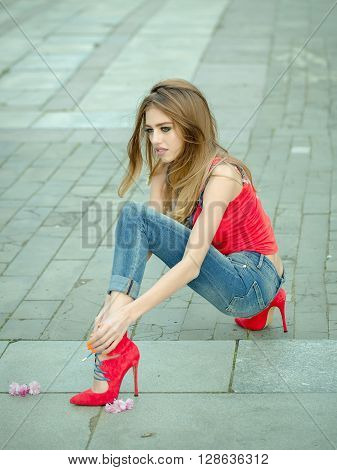 Beautiful And Sexy Girl Sits In High Heel Shoes
