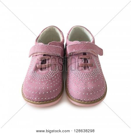 lovely pink childish shoes with laces and clasp isolated on white background