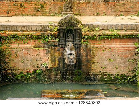 A traditional style ancient Stone Tap o f Nepal with running water in Bhaktapur.