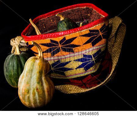 A Kiondo, also known as African Basket, with pumpkins. A kiondo is a sisal basket famous with the Kamba and Kikuyu communities of Kenya.
