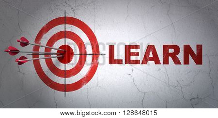 Success Learning concept: arrows hitting the center of target, Red Learn on wall background, 3D rendering