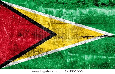 Guyana Flag painted on grunge wall. Vintage and old look