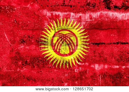 Kyrgyzstan Flag painted on grunge wall. Vintage and old look