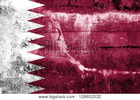 Qatar Flag painted on grunge wall. Vintage and old look