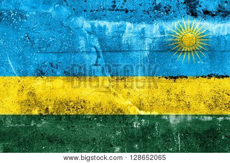Rwanda Flag painted on grunge wall. Vintage and old look