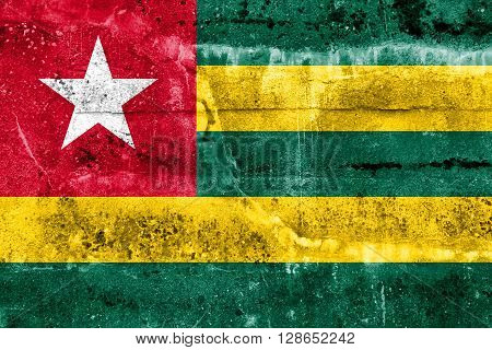 Togo Flag painted on grunge wall. Vintage and old look