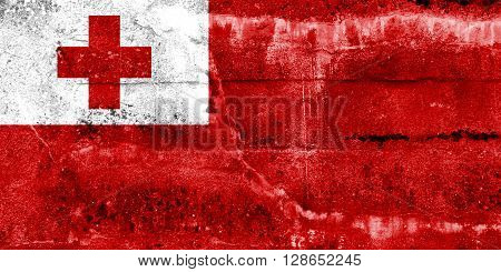 Tonga Flag painted on grunge wall. Vintage and old look