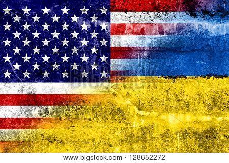 Ukraine And Usa Flag Painted On Grunge Wall