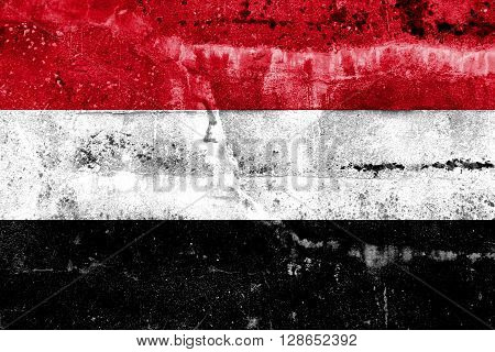 Yemen Flag painted on grunge wall. Vintage and old look