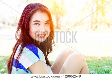 Asian woman smiling happy on sunny summer or spring day outside in park.