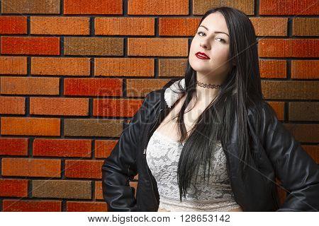Hot Girl Against Brick Wall