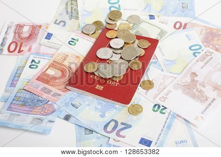 Travel on vacation lifestyle concept: cash money on table in mess with passport and change, euro little