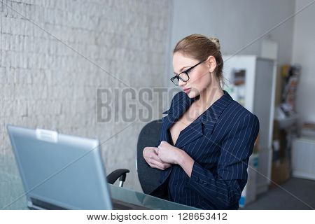 Blonde businesswoman in glasses lust online flirt