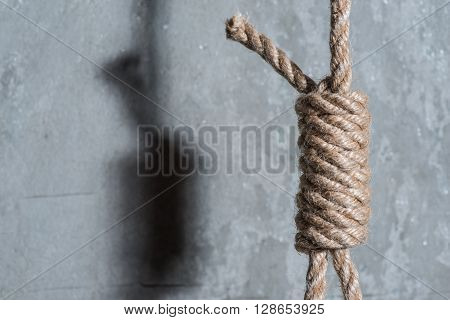 Hangman's Loop Over The Grey Concrete Wall