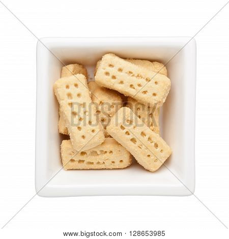 Shortbread biscuits in a square bowl isolated on white background